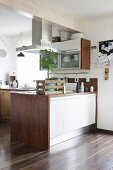 Small tree in rustic wooden crate on kitchen counter