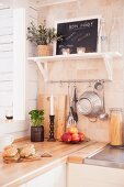 Shelf and serving hatch in corner of kitchen
