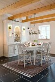 Festively decorated dining area in Scandinavian country house