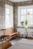 Windows, floral wallpaper and retro wooden bench in corner