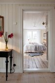 View from hallway into Scandinavian country-house-style bedroom