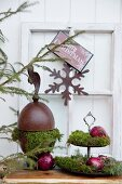 Vintage Christmas decorations against white wooden wall