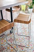 Designer bar stools on patterned cement tiles