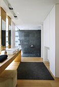 Modern bathroom with open, floor-level shower