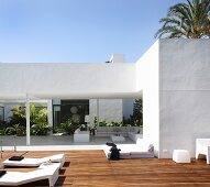 Modern architect-designed house with roofed terrace