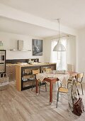 Dining table, retro chairs and sideboard in front of kitchen counter