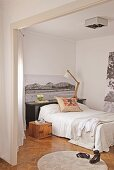 Black and white photos and scatter cushion on bed in bedroom