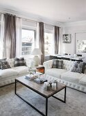 White sofas and coffee table in elegant lounge area