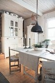 Dresser and wooden floor in shabby-chic dining room