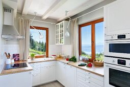 Modern country-house kitchen with view of landscape