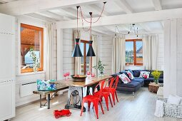 Open-plan, white, industrial-style interior with splashes of colour