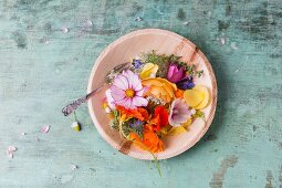 Various edible summer flowers on plate
