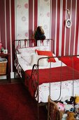 Hobby horse in vintage child's bedroom with red and white colour scheme
