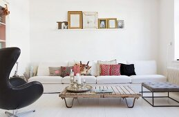 White sofa and upcycled coffee table in white living room