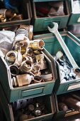 Various tools and lamp sockets in metal storage boxes