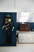 Kimono hung on blue wooden door in vintage attic room