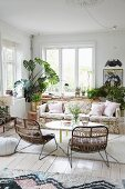 Floral couch and house plants in comfortable lounge