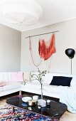 Orange wall-hanging in feminine lounge area