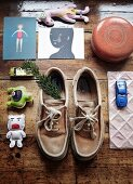 Toy car, cards, shoes and pine sprig on vintage wooden floor
