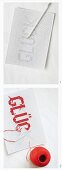 Cross-stitching a motto on perforated paper