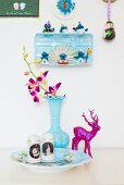 Collection of kitschy ornaments in pale blue and magenta