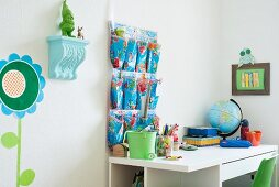 Desk and wall organiser in child's bedroom with blue and green accents