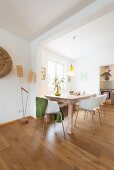 Wooden table and white shell chairs