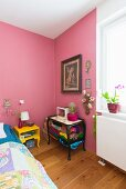 Kitschy eclectic bedroom with pink walls
