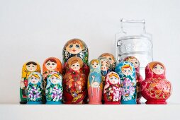 Collection of Russian dolls and tiffin lunchbox
