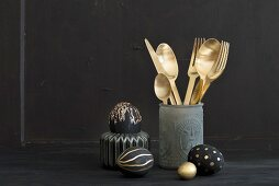 Gold cutlery and eggs painted black and gold