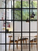 Modern furniture in dining room seen through lattice window