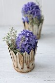 Blue hyacinths and thyme in rusty metal crowns