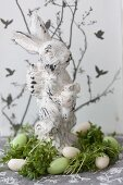 Easter bunny in nest of cress and sugar eggs