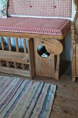 Bench with chicken pen in historical farmhouse