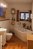 Mixture of old and new elements in bathroom of historical farmhouse