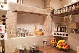 Niches above worktop in corner of rustic kitchen