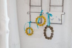 Wreaths of Craspedia and scabious hung form postcard rack