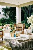 Various wicker furniture on summer veranda