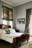 Dark wooden bed and stucco frieze in classic bedroom