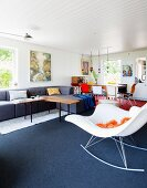 Modern rocking chair in eclectic open-plan interior
