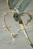 Romantic pearl heart on weathered chair