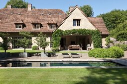 Luxurious country house with well-tended garden and pool