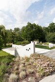 Concrete balustrade wall, terrace and pool in gardens