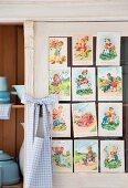 Vintage postcards with pictures of children on kitchen dresser