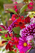 Autumn bouquet with dahlias on garden chair