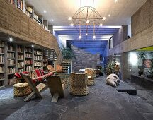 Designer furniture in open-plan interior of concrete house