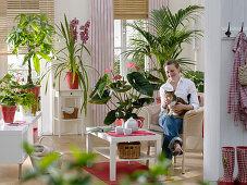 Living room with Anthurium andreanum (Flamingo flower), Cymbidium
