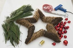 Star with red balls and pine branches