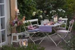 Evening terrace table decoration with lanterns, dahlia and hydrangea