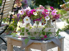 Bottles with summer flowers in bottle carrier